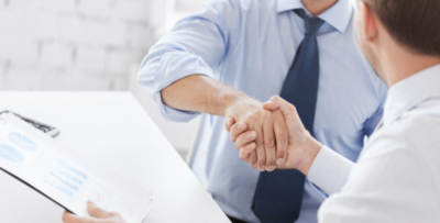 businessmen shaking hands in office after superior business opportunities